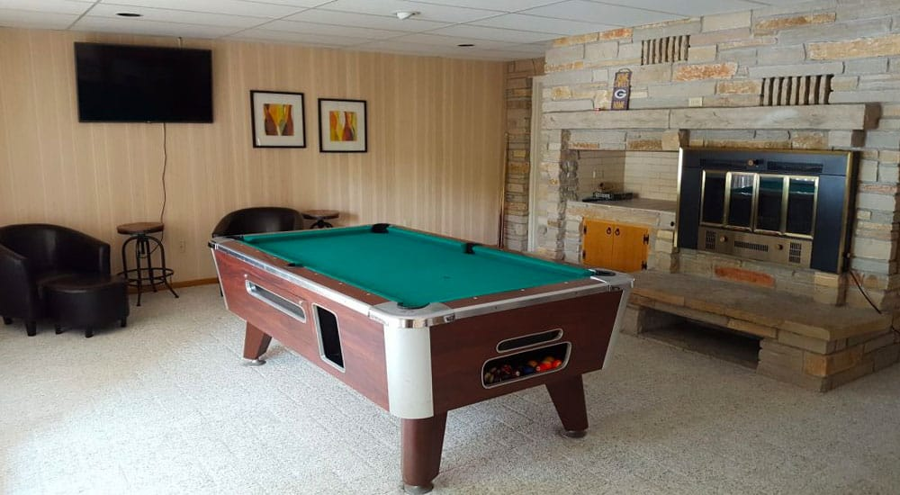 Play a few games of pool in the game room downstairs